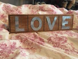 Vintage looking wooden love sign for wall or table decoration or wedding