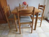 Extending kitchen dining table plus four chairs....good condition. £45.