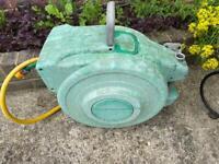 Auto reel garden hose