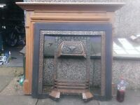 Fireplace with pine mantle peice cast iron surround and grate and art nouveau tiles