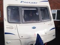 FIXED BED 4 BERTH BAILEY PAGEANT CARAVAN - TOP THE RANGE ,, WITH FULL AWNING & MOTOR MOVER