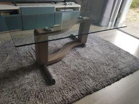 Glass/wood coffee table.
