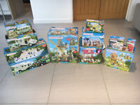 SYLVANIAN FAMILIES - EXTENSIVE COLLECTION OF 11 BOXED SETS WITH ADDITIONAL FIGURES