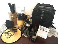 Nikon D300, VR 18 - 200mm lens, flashgun, trigger with backpack and accessories
