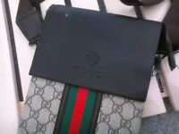 laptop and gucci pouch