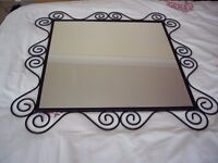 """Square wall mirror 22""""x22"""" Mounted in metal designed frame ."""
