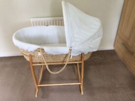 White Moses basket with rocking stand. From pet and smoke free home.