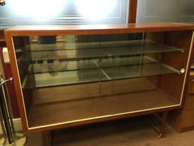 Display cabinet with sliding glass doors.