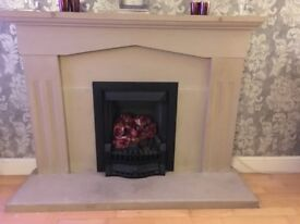 Fire Surround. stone Solid in beige. 54inches wide 40inches wide