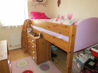 girls mid sleeper bed with chest of drawers and shelves unit