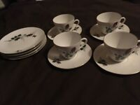 2 sets of cup and saucers with plates
