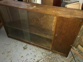 A solid wooden side bookcase with cupboard at end