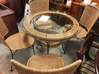 Glass and wicker table with 4 chairs