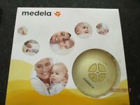 Medela Swing Electric Breast Pump and breast feeding bags, aids