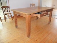 Large solid wood dining table with free local delivery