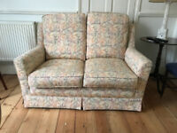 Wesley Barrell two-seater settee. Seats 2 people. Small, compact, quality, cream pattern sofa.