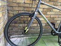 Pinnacle Neon Hybrid mountain road bicycle 8 speed gear shifter can also deliver