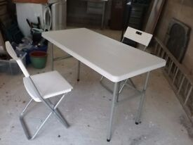 4ft plastic trestle table and 2 chairs