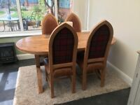 Solid oak extendable oval dining table