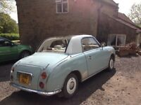 Nissan Figaro. Limited edition with all optional extras from factory. New engine, turbo and roof.