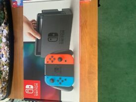Nintendo Switch with 5 games & carry case