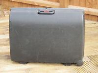 Hard Black Carlton Suitcase on wheels 76 x 56 x 24 cm. Lockable. Well used, but undamaged