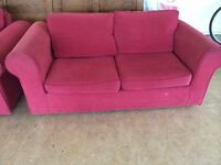Sofa bed and matching two seater sofa, red, in good order