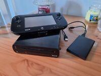 Nintendo Wii U with 63 games