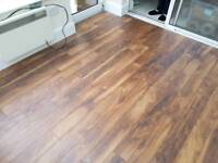 Laminate Hardwood Flooring and Skirting installation