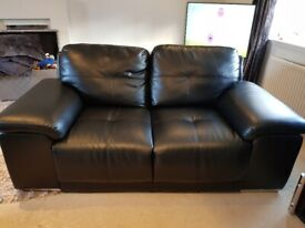 Two and three seater black faux leather sofas
