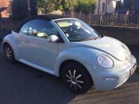 Ice Blue Volkswagen Beetle Convertible