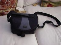 Camera Case, black padded with clip fastening, adjustable carry strap. £4.50. Torquay or can post.