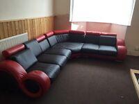 Black and red large corner sofa