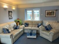 Cream leather suite - two x 2 seater sofas, recliner armchair, footstool (will split)
