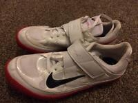 Red and white high jump track and field trainer spikes size 9