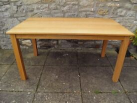 NICE VERY SOLID BLONDE COLOURED DINING TABLE QUITE HEAVY
