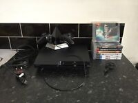 PS3 black slimline 500gb with 7 games