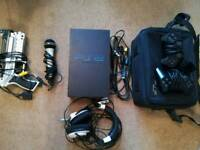 Fully functioning PS2 Console with 2 controllers, PS2 case bag, various accessories and games