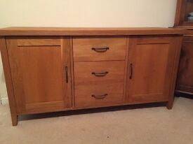 Solid light Oak Sideboard, 3 central deep drawers, 2 cupboards (either side), shelved. VGC