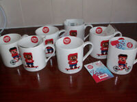 7 Brand New and Unused Comic Relief Mugs