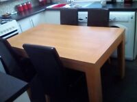Modern oak dining table and four high back chairs