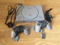 PS1, Playstation One original console with cables, controllers & 8 games for sale.