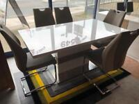 New**Stunning high gloss extendable table and 6 chairs - delivery available !!!