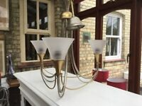 Triangular candle style light fitting.
