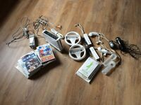 Nintendo Wii an assorted games 10, 2 steering wheels and nunchucks,