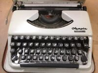 Olympia Splendid 66 old typewriter in a carry case.