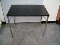 6 solid black office tables with stainless steel legs. Very strong - buyer collects