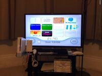 Wii Console + 9 games and accessories