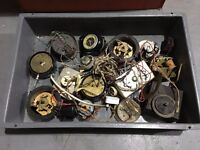 Various trays of electric clock parts - English and continental