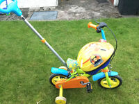 Toddlers bike with a handle for an adult to help push.